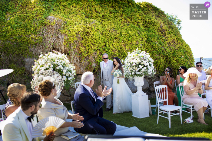 The bride arrives at the Castle Lanza di Trabia, emotions time in this wedding photo