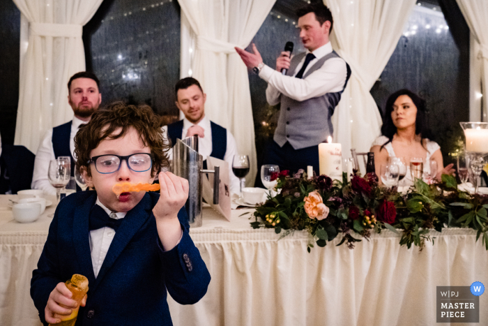 IE wedding photography from the Glasson House of a Kid blowing bubbles during speech