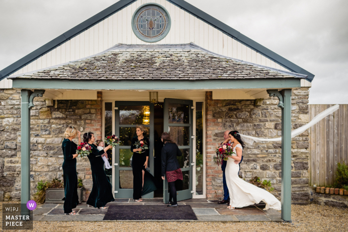 wedding photography from Clonabreany Village of the Bride losing veil in the wind
