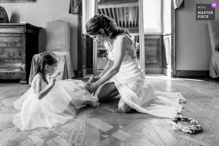 FR wedding photo from Château d'Epeyssoles France of the Bride and her daughter preparing for the ceremony