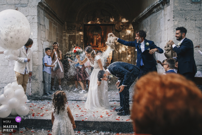 wedding photography from Chiesa of the Wedding rice tossed on the bride and groom