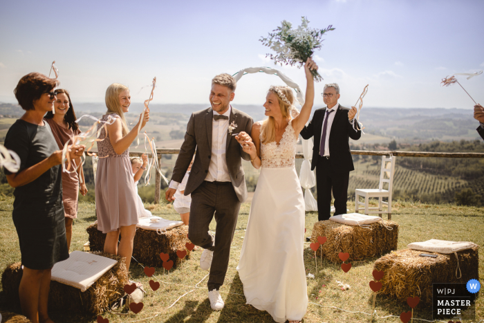 Outdoor, beach wedding photography from Agriturismo Crealto, Alfiano Natta, Italy showing - Here comes the Bride & Groom