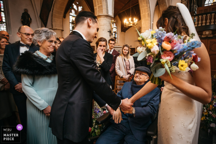Belgium Wedding Photography | the bride's father evokes a sad response while entering church (he passed away 1 month later because of a tumor)