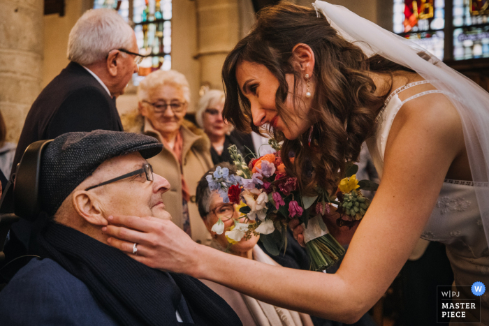 Belgium Wedding Image | the bride carresses her palliative dad right after the ceremony