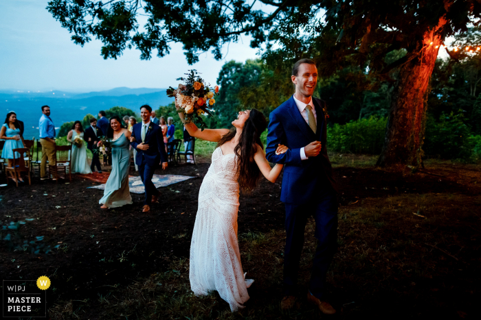 wedding photography from Asheville, NC showing That: I just got married feelling for the bride and groom after their outdoor, evening ceremony