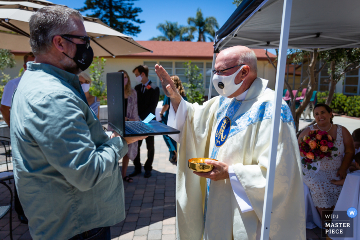 California wedding photography at Assumption Church, Ventura of the blessing the Zoom guests