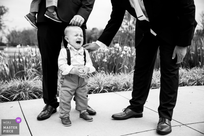 Milwaukee Wisconsin Maid of honor's son crying because he wanted to play with a frog near the pond at the outdoor Ceremony Location