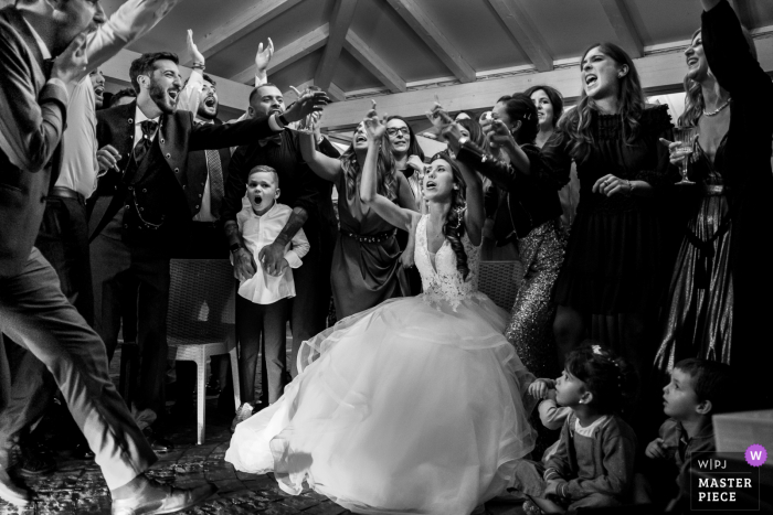 The Bride, Groom and their guest are divided in 2 teams: Men vs Women enjoying in a song contest at the Reception Venue at Villa Domus Petra, near Rome