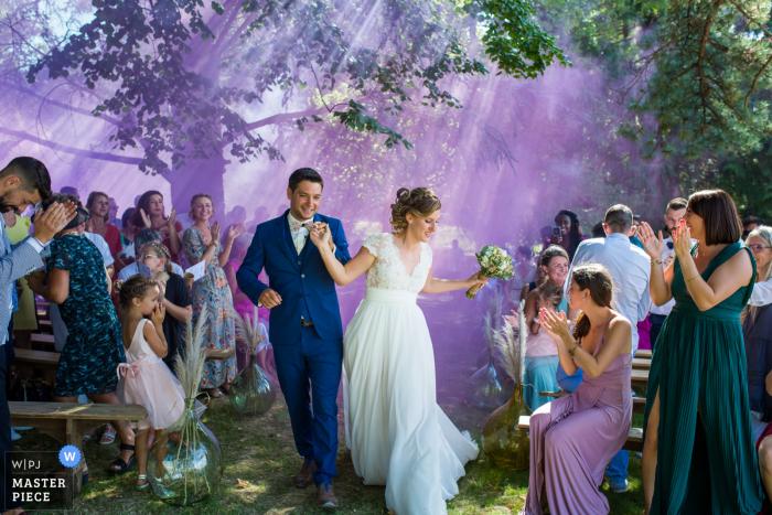 Auvergne-Rhône-Alpes Ceremony photography with amazing purple smoke outdoors