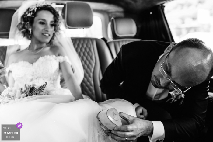 Istanbul wedding groom looks under the shoes to see whose name has been erased