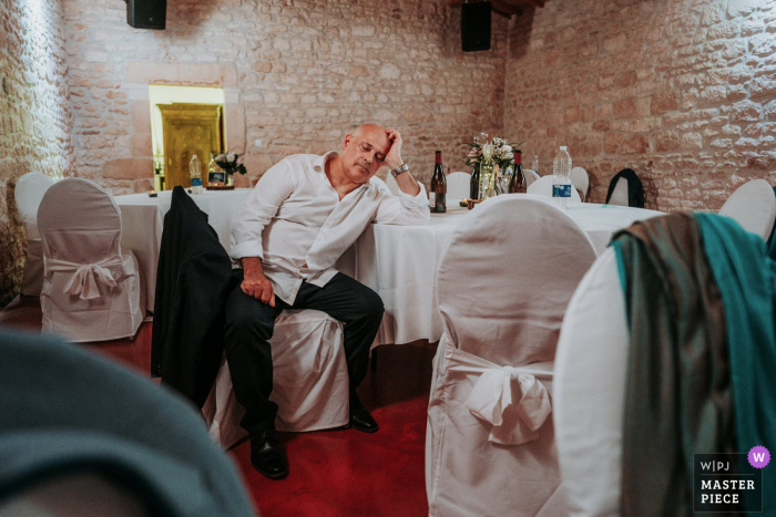 Image showing the father of the groom who sleeps during the evening wedding at Chateau de Crazanne France