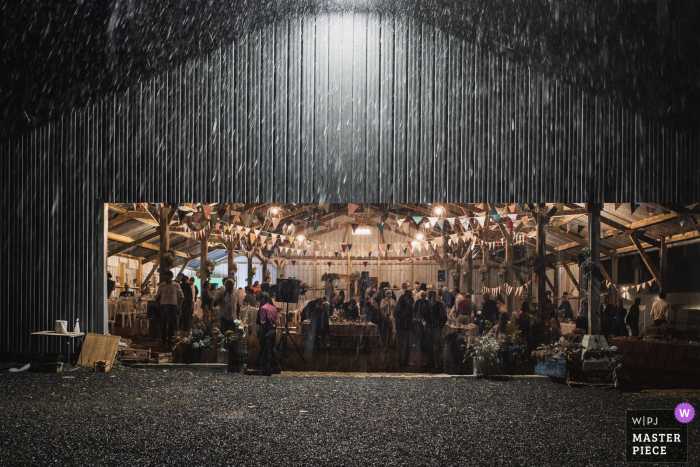 Carhaix, France Rain during the evening barn wedding indoor reception party