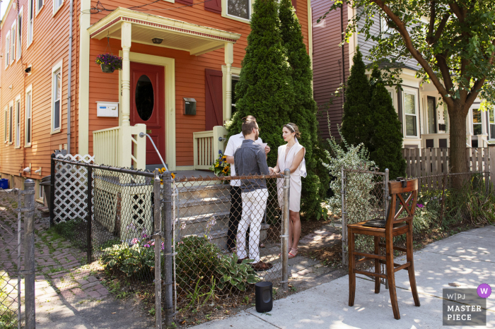 Front porch Ceremony at bride and groom's house with only officiant a their home Home in Cambridge, Massachusetts