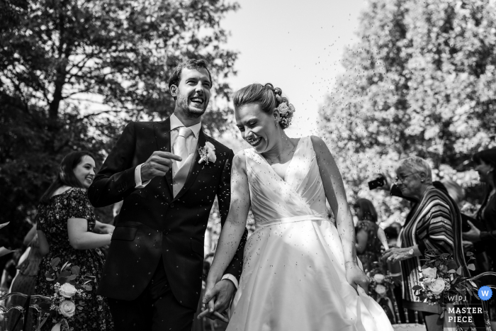 Confetti for the bride and groom following their outdoor wedding at Strassoldo Castle, Cervignano, Udine, Italy