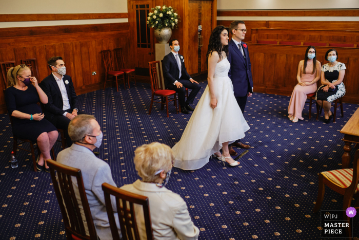 A socially distanced scene during the wedding ceremony at The Old Courthouse, Guildhall, UK