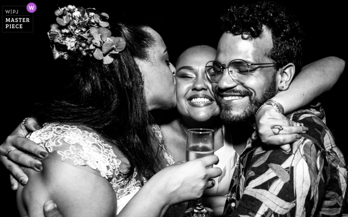 Alagoas wedding photo from a Brazil Reception showing love in a friends hug