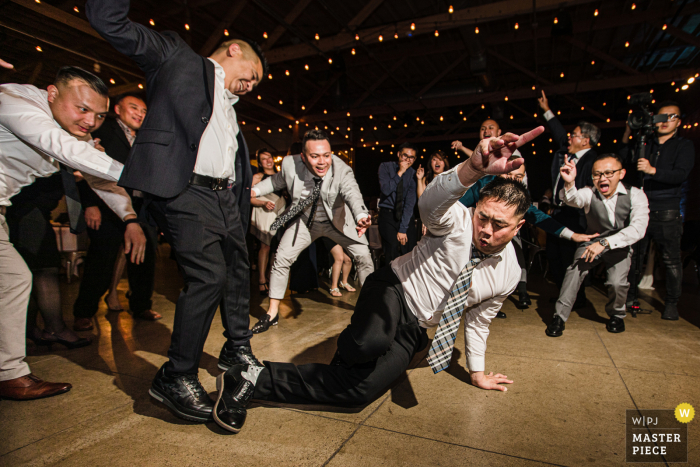 Wedding photography from a reception in San Jose, California of Guests partying before Pandemic