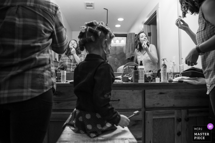 Bride, flower girls and bridesmaid putting on makeup at Wit's End, Ellijay, GA
