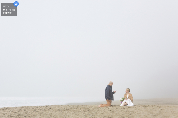 California wedding photography from baker beach of the couples vows in fog