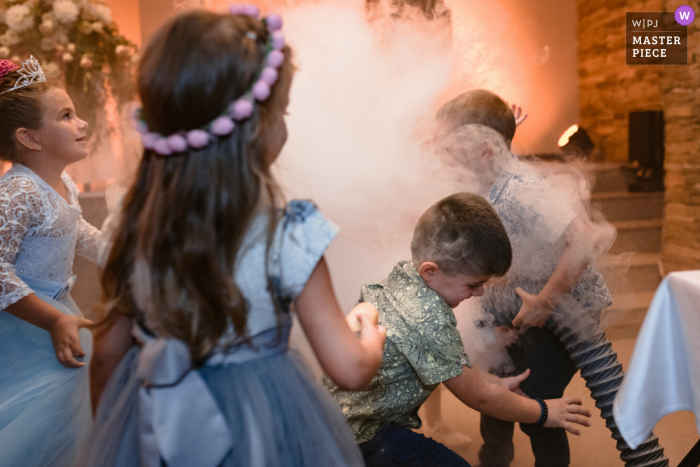 Kids playing with the smoke machine during the first dance at the Best Western Inter Expo Hotel in Sofia, Bulgaria