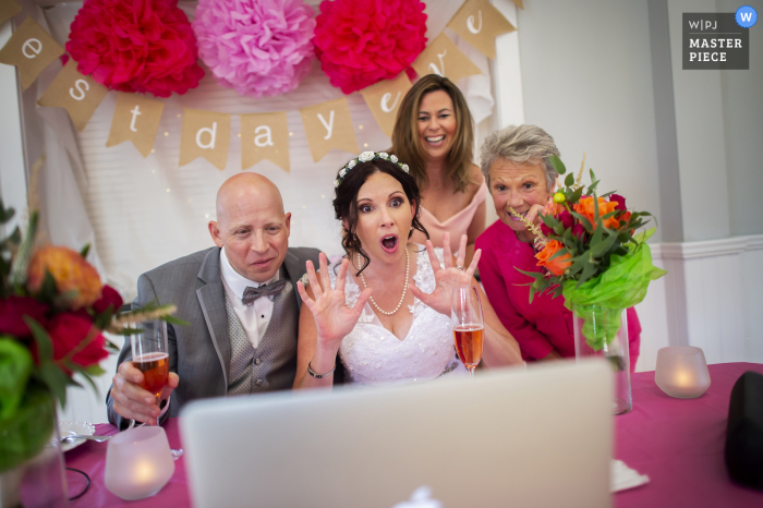 The bride, groom, mother of the bride and a friend chats with guests during a virtual Zoom receiving line at the Cornelius V. Kelly Community Center