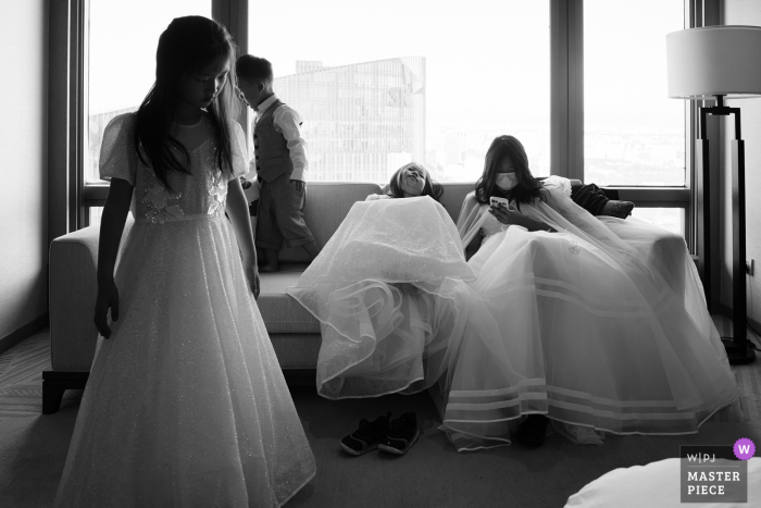 Beijing bridal party getting ready for the ceremony, as a flowergirl falls asleep