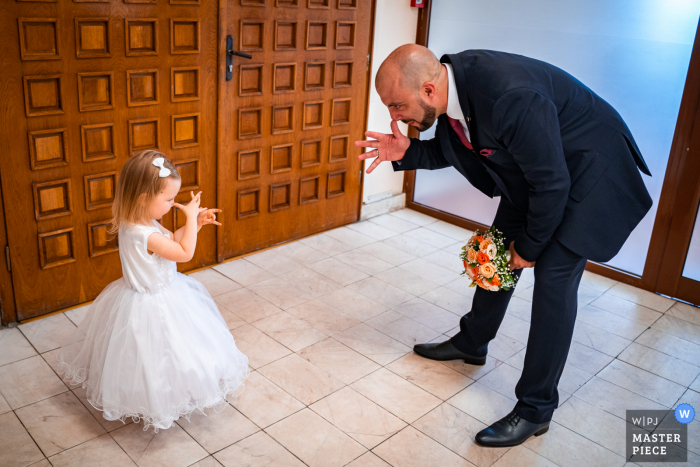 Sofia wedding photo from the Bulgaria Ceremony Location	of a Little bridesmaid learning tricks