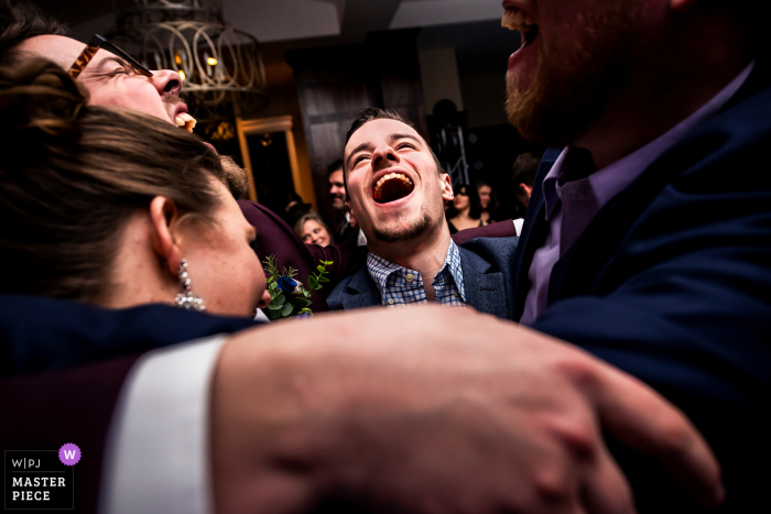 wedding guests singing on the dancefloor at the Pinery at the Hill in Colorado Springs