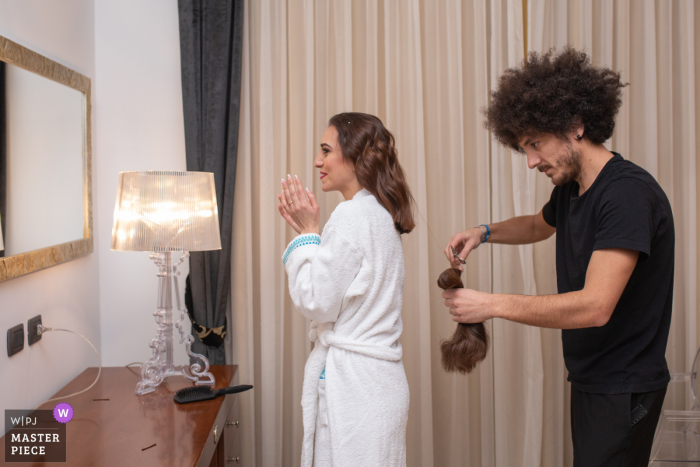 Wedding photo from Sicily during getting ready of the bride getting a trim of her long hair