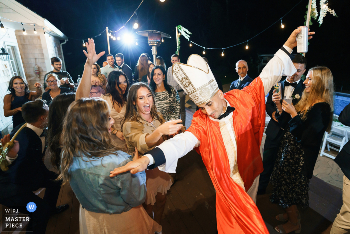 Bride's brother, who did the ceremony, dressed up as a priest in West Yarmouth, MA