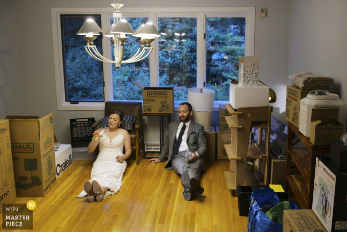bride and groom tired after hosting a wedding in their new home in eastern Massachusetts