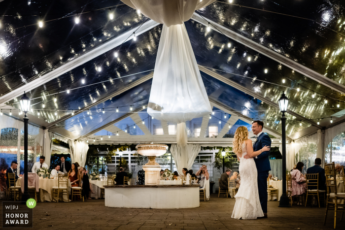 PA bride and groom enjoy the dance floor to themselves while their guests are being served salads