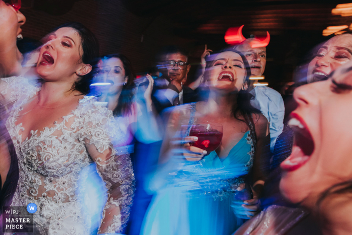 Wedding photography from the Brazil Reception Location of the Bride and guests dancing