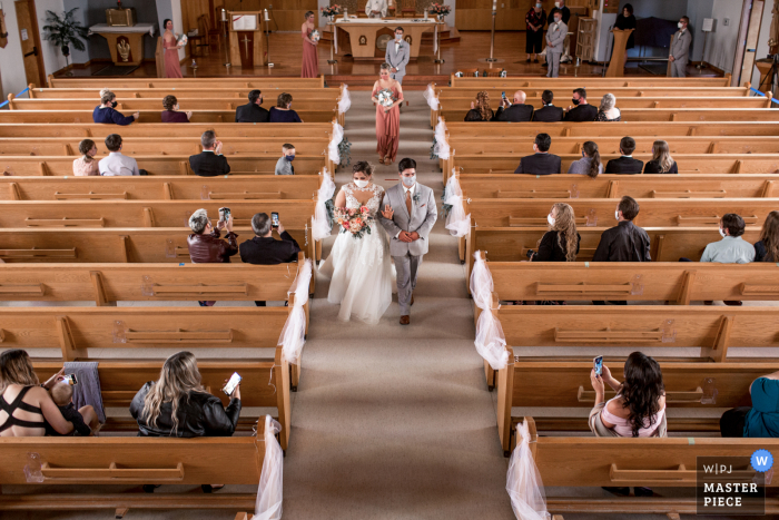 Adhering to the social distancing rules for a wedding ceremony at a church in Sudbury, Ontario
