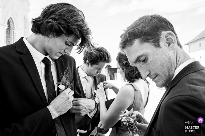 Friends of the bride and groom prepare before the religious ceremony in France