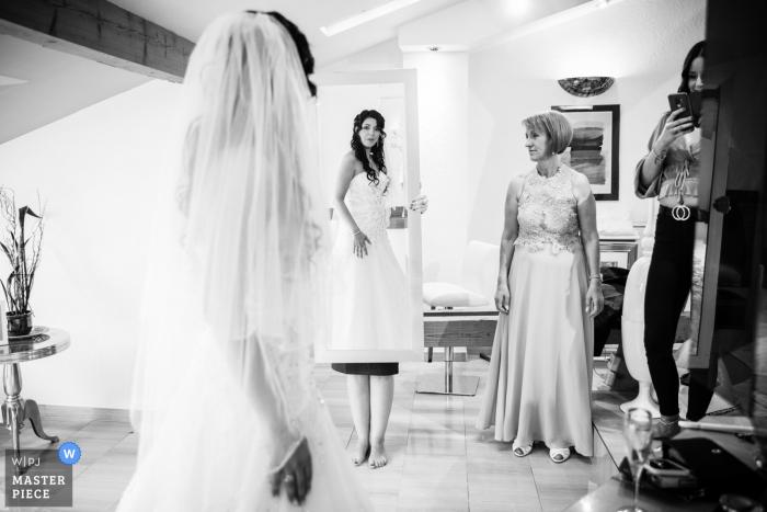 Bride getting ready in her hotel room in Switzerland
