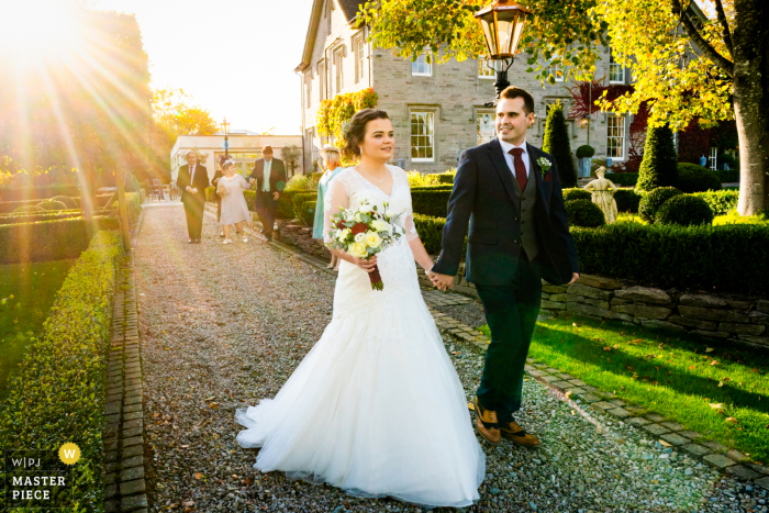 Bride and Groom lead their guests to the wedding breakfast at the Lemore Manor, Herefordshire, UK