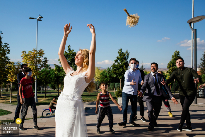 Istanbul bride throws her bouquet to a group of men, as there were no single women to catch the flowers