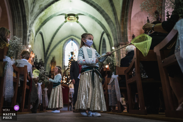 Wedding photography from a Saint-Suliac's church, FranceCeremony of flower girls tending to the guests