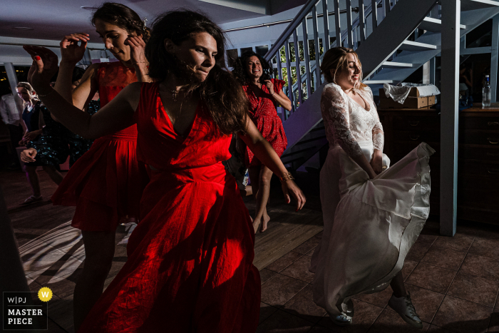 Wedding photography from a Auvergne-Rhône-Alpes reception of the dancing bride