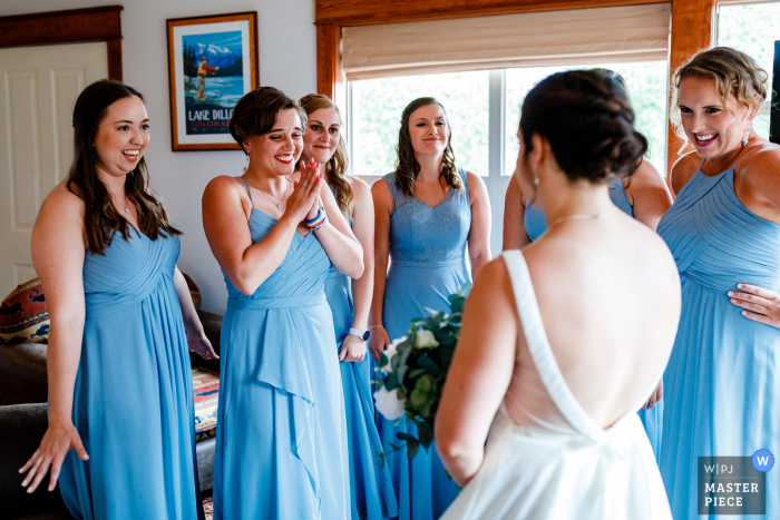 Bridesmaids see their friend for the first time for the bride's wedding in Colorado