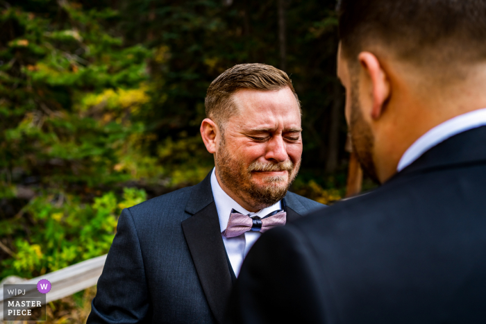 Groom gets emotional during first look at Maroon Bells, Aspen, CO