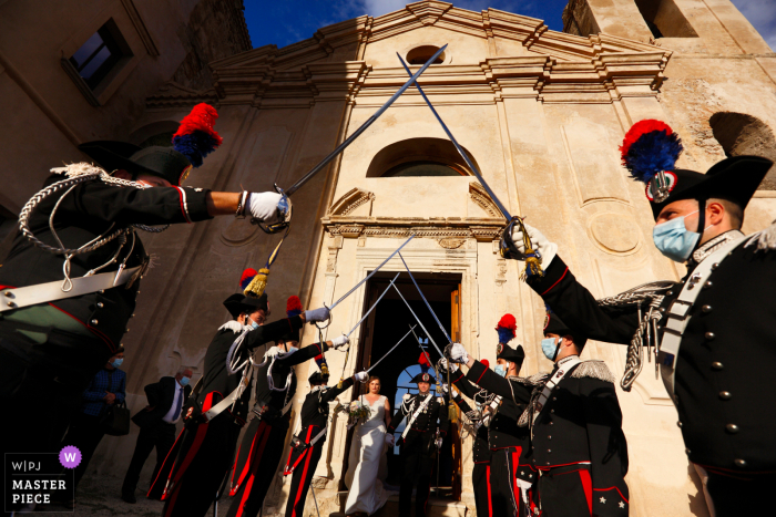 Wedding photography from Castello Carafa di Roccella Jonica, Italy of the Corps of Arma of the Carabinieri, Picket of Honor during the exit of the spouses