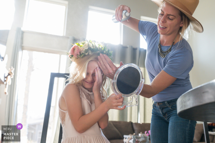 Colorado wedding photography of the Daughter of the Groom getting hair done