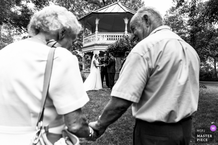 Minnesota wedding photography of the White Bear Lake Grandparents looking at the couple