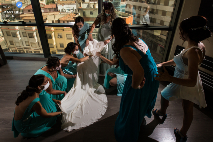 Bride dress moment with bridesmaids wedding photo from bride getting ready in Toledo