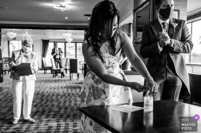 East Riding of Yorkshire wedding photography of guests applying hand sanitizer