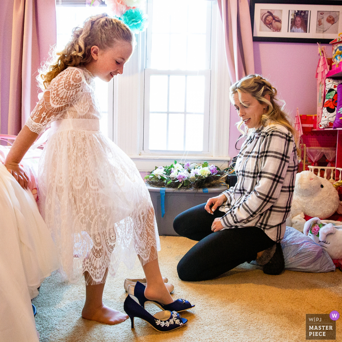 The bride, (Mom), was helping her little girl get dressed and she wanted to try on Mom's shoes in Long Island, NY