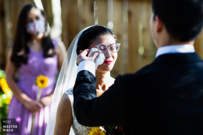 Oakland wedding photography of the groom and bride - Let me wipe the happy tears for you
