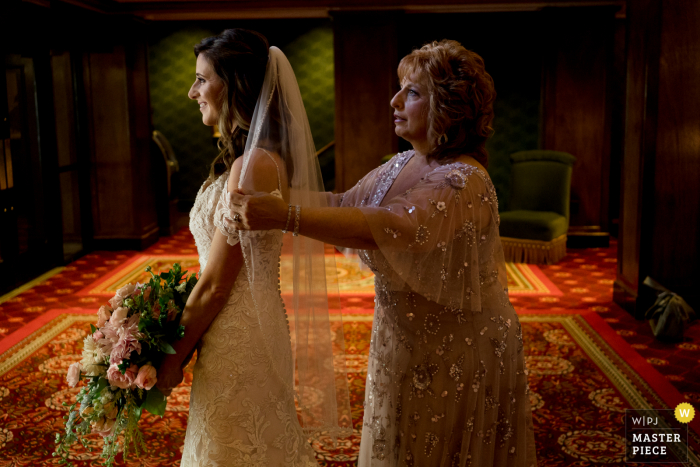 Mother of the bride helps bride with her veil at the Graduate Hotel in Providence, Rhode Island